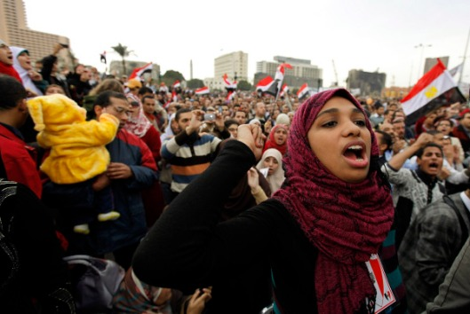 Protesters chant anti-government slogans during demonstrations at Tahrir Square in Cairo